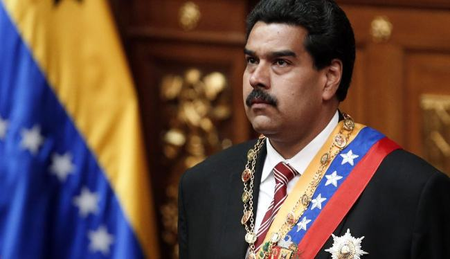 Venezuelan Vice President Maduro looks on during his swearing-in ceremony as caretaker president following the death of President Chavez in Caracas