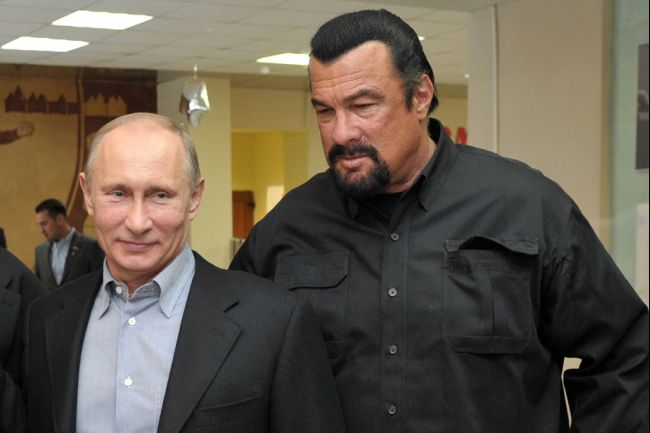 Russia's President Vladimir Putin and American action movie actor Steven Seagal visit a newly-built sports complex in Moscow.