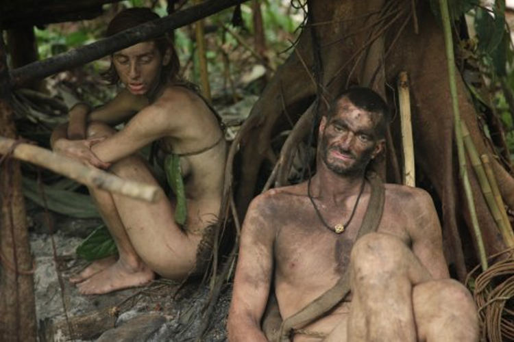 """Kim and Shane resting in the shelter they built on Discovery's """"Naked and Afraid""""."""