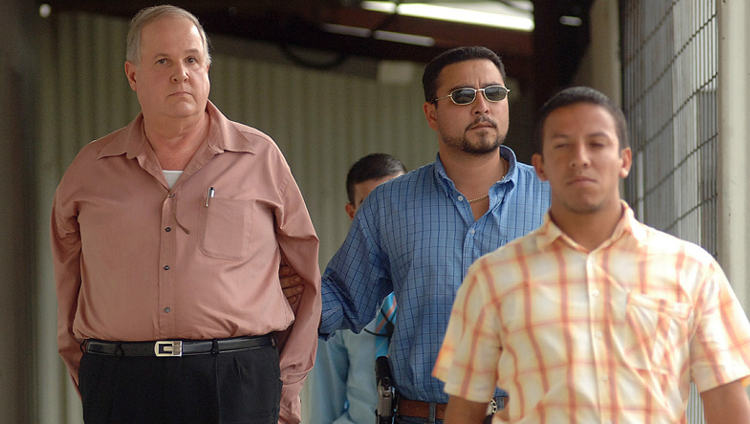 Luis Milanés Tamayo (left)  on June 20, 2008, being escorted to Costa Rica from El Salvador. Milanes was wanted by Costa Rican authorities for fraud.