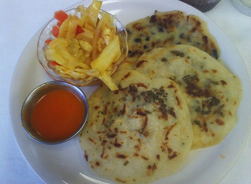 Pupusa: a traditional Salvadorean dish made of a thick, handmade corn tortilla filled cheese, cooked meat or refried beans.