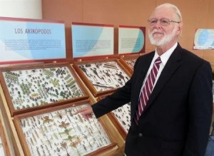 U.S. Biologist Richard Whitten poses in front of a part of his insect collection on exhibit at the University of Costa Rica in San Jose, Costa Rica, Friday, Oct. 25, 2013. Whitten, who has lived in Costa Rica for over a decade, donated his collections of giant scorpions, tarantulas, grasshoppers, butterflies, beetles and other insects to the University of Costa Rica, where it is being exhibited this week. (AP Photo/Javier Cordoba)