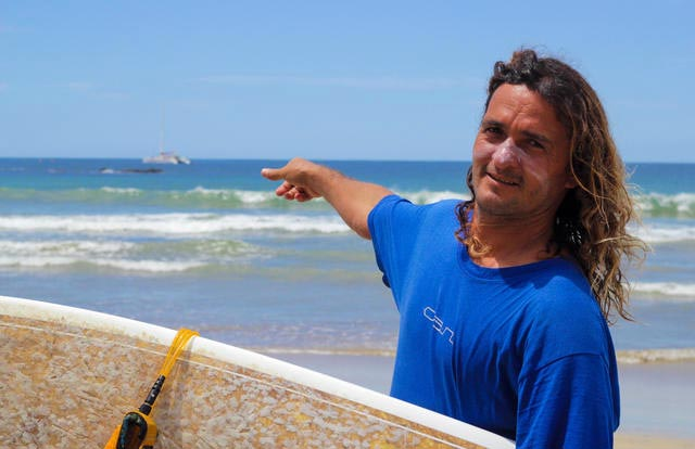 Luis Sequeria fought off the croc with his surf board in the rescue of the tourists. Photo: Genna Marie Robustelli, Tico Times