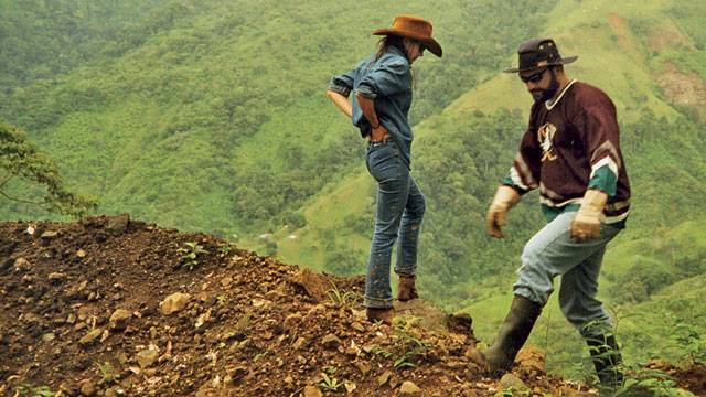 John and Ann inspecting road damage after a landslide. Photo: Courtesy of the Patton family