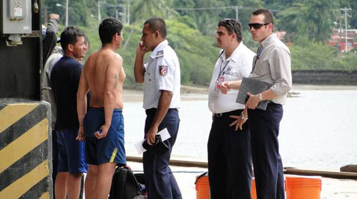 Costa Rica's Coast Guard and Immigration officials help out the Ecuadorian fisherment rescued by the US Navy in Pacific watrs. Photo: La Nacion, Freddy Parrales