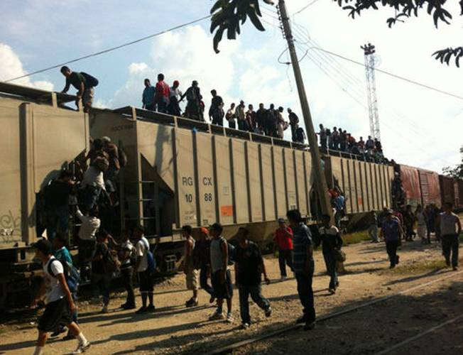 """Gang and organized crime violence are the main reasons Central Americans seek refuge in other countries, according to the United Nations High Commissioner's Office for Refugees (UNHCR). Above, migrants use the train known as """"The Beast"""" in Mexico to travel to the United States. (Courtesy of La 72 Refugee Home)"""