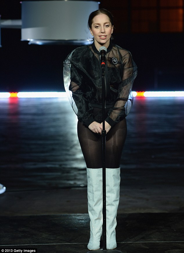 Pre-flight outfit: Before she donned the fiber optic shell of the flying dress, Gaga stripped down to a black leotard and white go-go boots