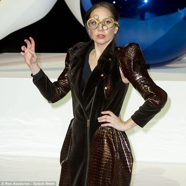 After-flight outfit: Gaga goes steampunk with a metallic high-fashion coat, extreme platforms and goggles