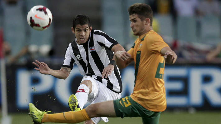 Costa Rica's Christian Gamboa, left, and Australia's Dario Vidosic compete for the ball during their soccer friendly match in Sydney, Tuesday, Nov. 19, 2013. (AP Photo/Rick Rycroft)