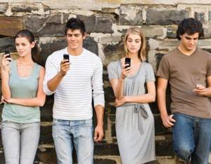 young-adults-texting-lg-300x234