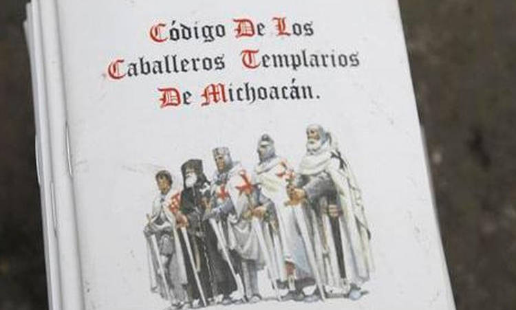 """A booklet reading """"Code of the Caballeros Templarios (Knights Te"""