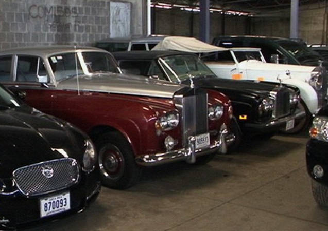 The Liberty Reserve vehicles stored in an enclosed warehouse, waiting to be auctioned off.