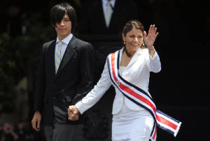 Laura Chinchilla with her teenage son during the 2010 inauguration ceremony of her assuming the presidency,
