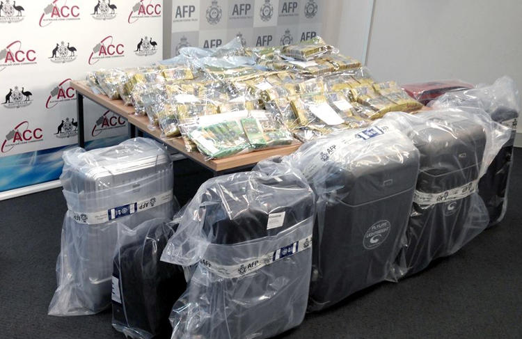 Have you ever wondered what almost $6 million dollars looks like? This cash was displayed under AFP guard during a press conference in Sydney today. But it's only a drop in the ocean.