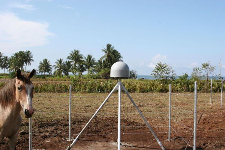 . GPS Antenna and local horse on Nicoya Peninsula. Photograph courtesy of Marino Prott