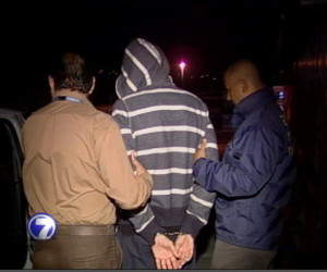 Immigration officials Wednesday morning escort an American to the San José airport for deportation to the U.S.