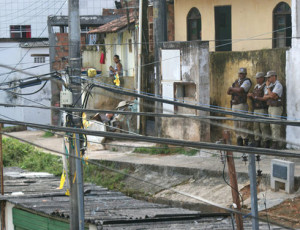 Military police officers watch over the Calabar favela in Salvador, the state capital of Bahia. In 2011, the city installed its first community security base in the favela. (Courtesy of Alberto Maraux/Public Safety Secretariat of the State of Bahia)
