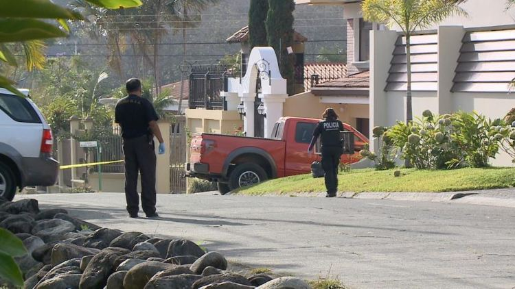 Police raid the home of Quintavalle in San Rafael de Escazú.