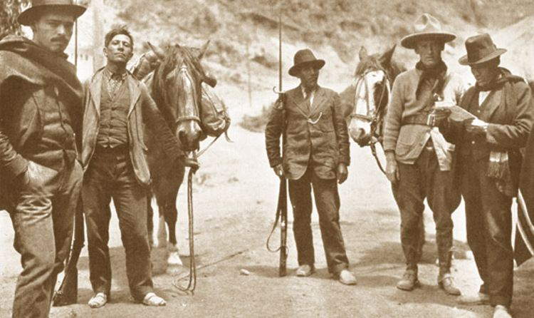Even Aime Tschiffely (second from the right) was continually harassed by border guards during his legendary journey from Argentina to New York.