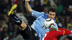 World Cup: Uruguay Knocks Out Ghana on Penalties. Uruguay's Andres Scotti, left, competes for the ball with Ghana's Asamoah Gyan, right.