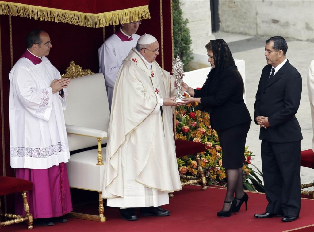 Pope Francis receives the relic of Pope John Paul II from Floribeth Mora