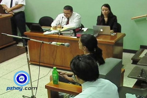 Anne Patton behind the microphone giving testimony. | Photo courtery of pzhoy.com