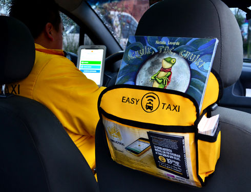 As of April 24, taxi passengers in Bogotá, the capital of Colombia, have access to 3,500 standard books and 100,000 digital books through the Bibliotaxi project. (Courtesy of Easy Taxi)