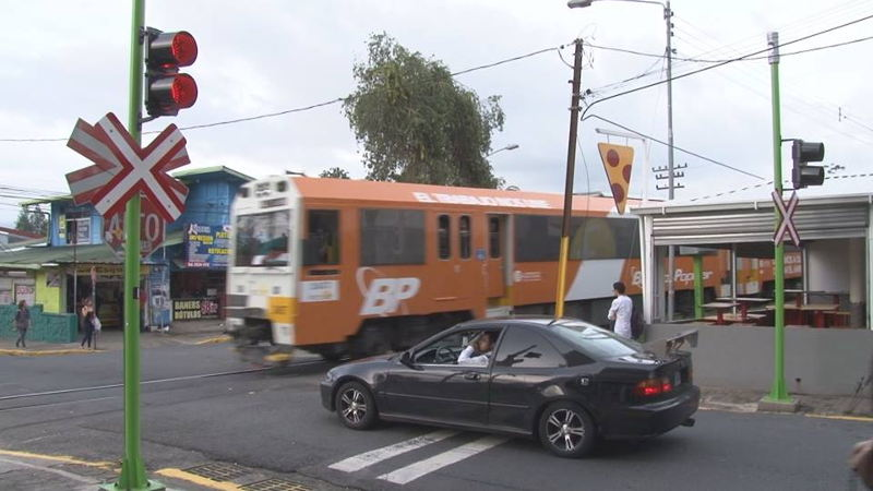 The urban train and cars are forced to share the same roads