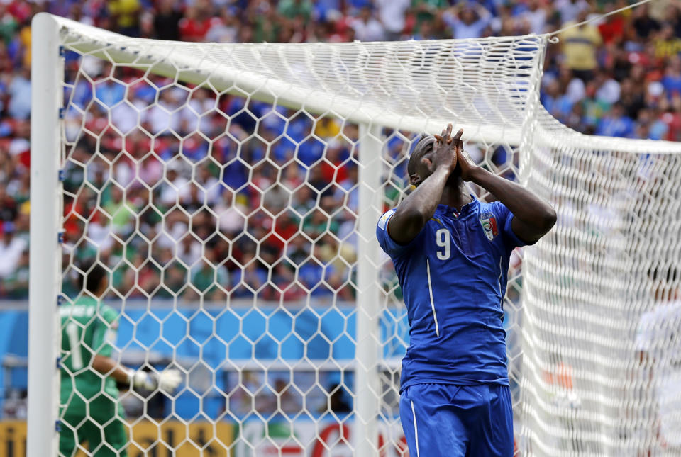 Italy's Mario Balotelli reacts after missing a chance during the group D World Cup soccer match between Italy and Costa Rica at the Arena Pernambuco in Recife, Brazil, Friday, June 20, 2014. (AP Photo/Frank Augstein)
