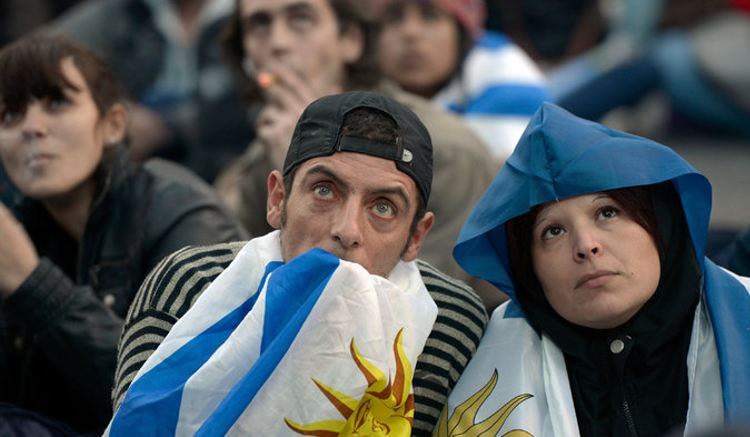 Fans in Montevideo watching Uruguay's first match, against Costa Rica. In a seemingly fitting story line, the Uruguayans had early success but fell, 3-1. Credit Matilde Campodonico/Associated Press