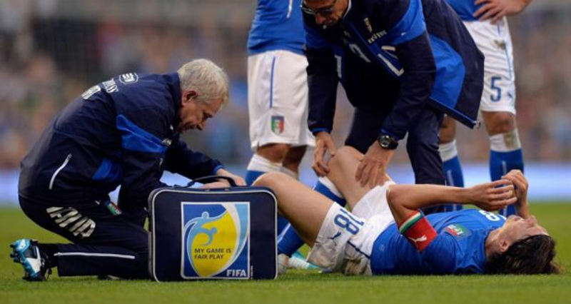 Italy's Riccardo Montolivo receives medical attention after breaking his leg at Craven Cottage last night. Photograph: Toby Melville/Reuters