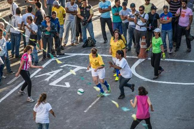 Brazilian prostitutes and Christian evangelicals play soccer match on World Cup sidelines