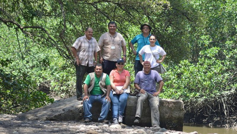 Members of Costa Rica's Environmental Administrative Tribunal (TAA) take a break during an inspection of damage to wetlands in Puntarenas by invading farmers. Back centre: TAA president, judge José Lino Chaves. Credit: Diego Arguedas Ortiz/IPS