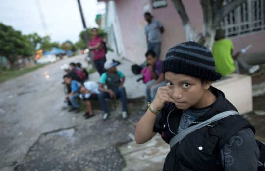 n this June 19, 2014 photo, a 14-year-old Guatemalan girl traveling alone waits for a northbound freight train along with other Central American migrants, in Arriaga, Chiapas state, Mexico. The United States has seen a dramatic increase in the number of Central American migrants crossing into its territory, particularly children traveling without any adult guardian. More than 52,000 unaccompanied children have been apprehended since October. (AP Photo/Rebecca Blackwell)