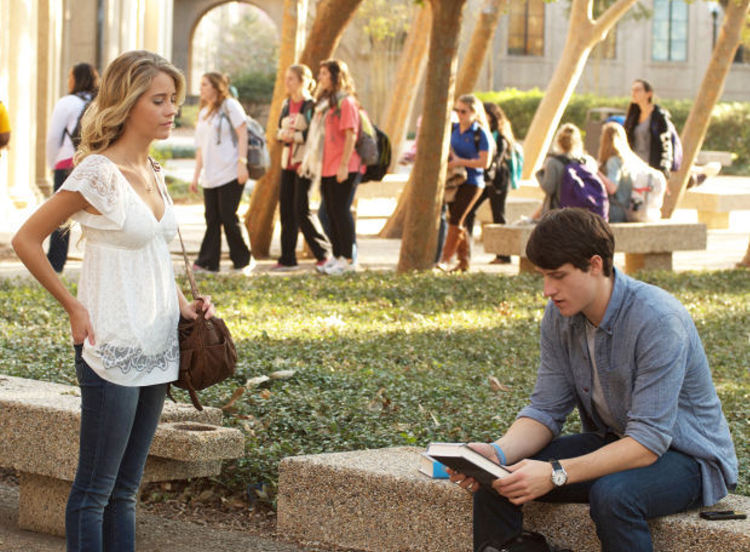 """Josh Wheaton, played by Shane Harper, and his girlfriend, Kara, played by Cassidy Gifford, talk on campus after the college freshman is challenged by his professor to prove the existence of God in the Pure Flix Entertainment movie """"God's Not Dead."""""""