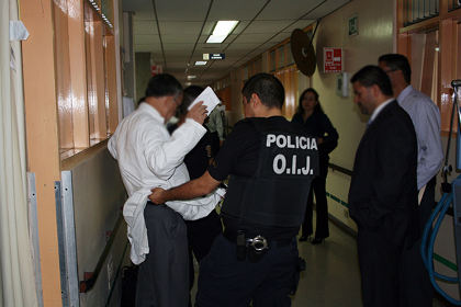 Dr. Francisco José Mora Palma, the nephrologist who oversaw Ms. Dorin's transplant, is arrested on June 18, 2013 at Hospital Calderón Guardia. The photo was provided by the OIJ in Costa Rica in which they obscured Dr. Mora's face in accordance with Costa Rican law.
