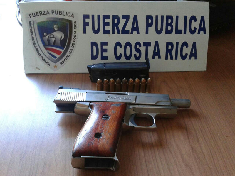The gun and ammunition was being kept under a mattress until the 12 year old brought it school. Photo courtesy of Ministerio de Seguridad Publica