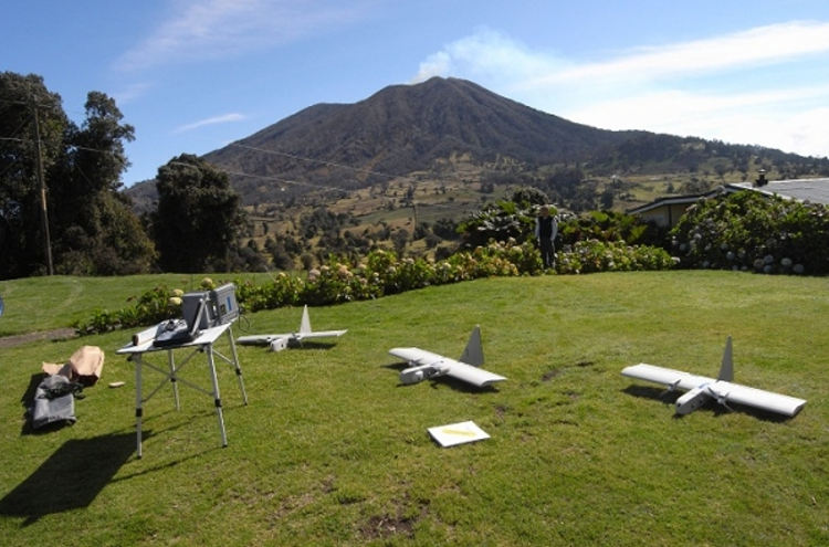 Research scientists used three Aerovironment RQ-14 Dragon Eye UAVs from the United States Marine Corps to carry instrument payloads for up to an hour within a volcanic plume. Credit: NASA/Matthew Fladeland