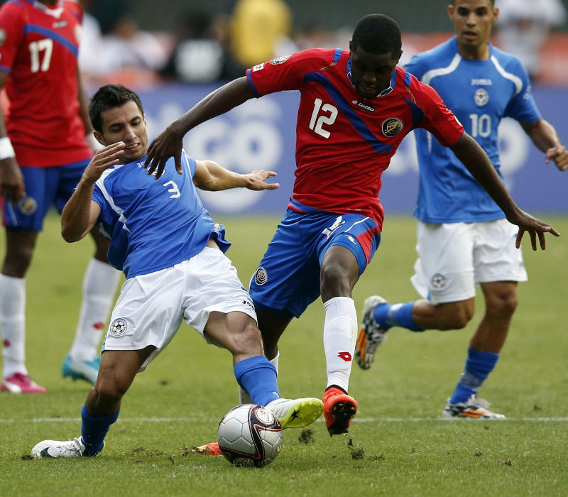 Nicaragua defender Manuel Rosas, left, and Costa Rica forward Joel Campbell battle for the ball during the second half.  Associated Press