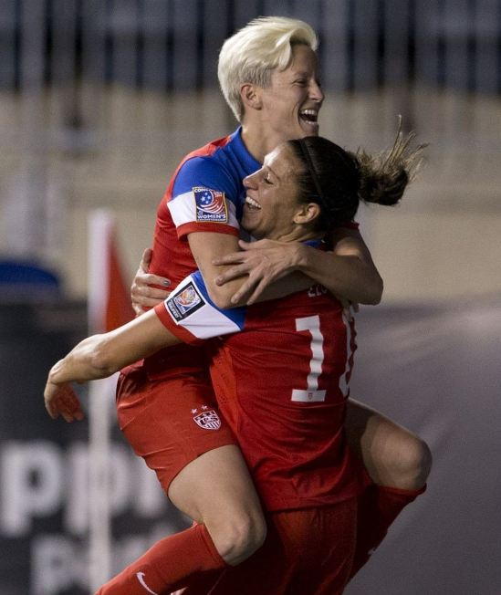 Carli Lloyd catches Megan Rapinoe after the Americans took a 2-0 lead against Costa Rica at PPL Park. (By Mitchell Leff — Getty Images)