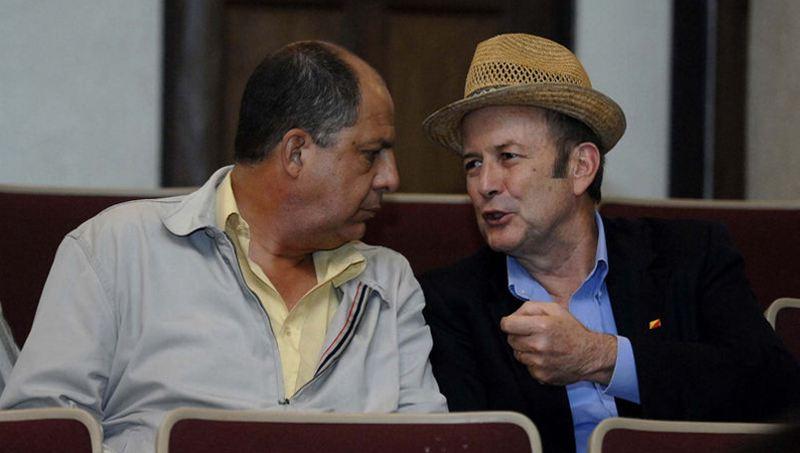 President Luis Guillermo Solís (left) and legislator Ottón Solís (right).
