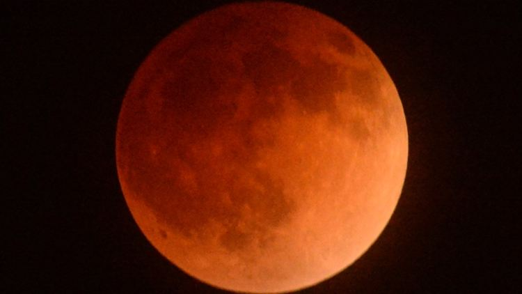 The moon turned brownish orange earlier this year during this eclipse on April 15, as seen from Los Angeles. The second total lunar eclipse in a series of four takes place early Wednesday morning. (Gene Blevins/Reuters)