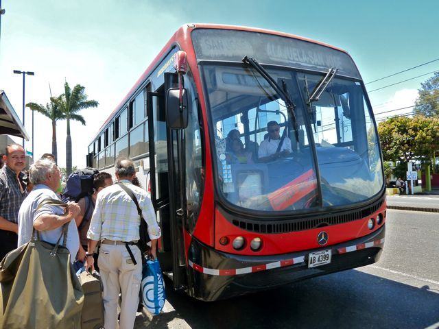 Taking bus in front of the San José airport. Photo: http://www.travelexperiencecostarica.com/costa-rica-transportation-bus/