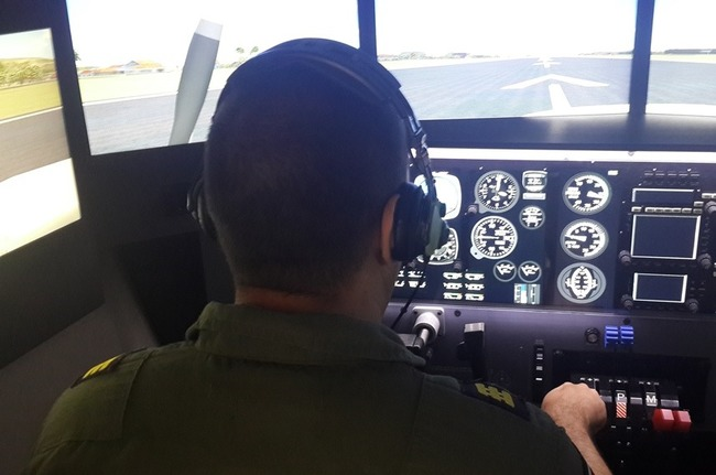 Flight simulator: A pilot trains on a sophisticated flight simulator. Costa Rican Aerial Surveillance Service (SVA) pilots will train with this type of flight simulator, which was donated by SOUTHCOM.    [Ministry of Public Security of Costa Rica]
