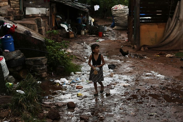 A young child walks home in an area known for heavy drug dealing on July 18, 2012 in Tegucigalpa, Honduras. Honduras now has the highest per capita murder rate in the world and its capital city, Tegucigalpa, is plagued by violence, poverty, homelessness and sexual assaults. With an estimated 80% of the cocaine entering the United States now being trans-shipped through Honduras, the violence on the streets is a spillover from the ramped rise in narco-trafficking. The non-governmental organization Doctors Without Borders has set up a program in the capital that looks to provide medical and psychological care to the homeless population. Each day a team goes out into the streets to meet with vulnerable groups of homeless to assess their needs. Honduras: Facing an epidemic of urban violence | Médecins Sans Frontières (MSF) International