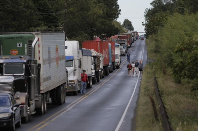 Hundreds of trucks line the Ruta 32 awaiting the re-opening of the only major route to and from  the Caribbean coast,