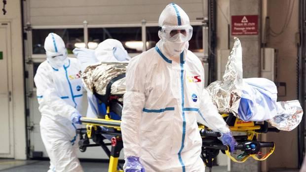 Cuban doctor Felix Baez Sarria, who contracted Ebola in Sierra Leone, arrives on a gurney at the Geneva University Hospital in Geneva, Switzerland, on Nov. 21, 2014. (AP)