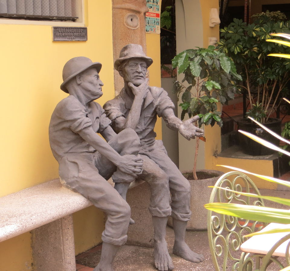 """""""The Conversation"""", one of several works at the Don Carlos, by sculptor Luis Enrique Castillo"""