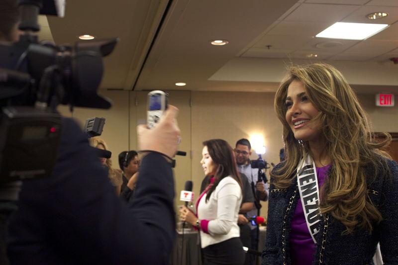 Miss Venezuela Migbelis Castellanos talks to the press in Miami.