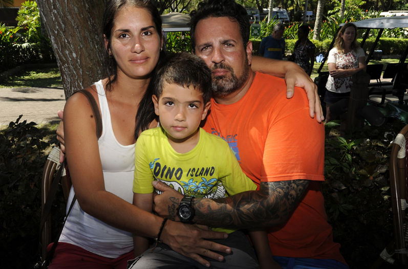 tiana López (7 months pregnant), Aracelio Garcia and his 5 year old son survived the tragedy. | GRACIELA SOLIS